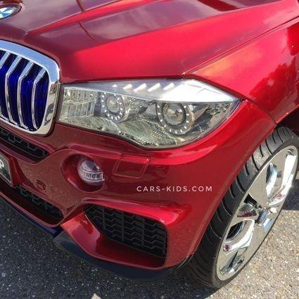 Электромобиль BMW X5 F15 красный (резиновые колеса, кожа, пульт, музыка, усиленный аккумулятор, ГЛЯНЦЕВАЯ ПОКРАСКА)